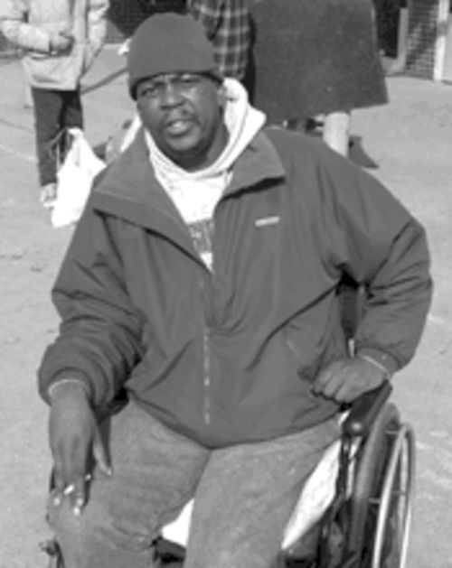 Odis Monroe, homeless and disabled, lost treasured family photos when the city threw his possessions into a garbage truck.