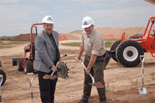 Digging for coe pies: Panda Energy Vice President Kyle  Woodruff, CEO Todd Carter and COO Darol Lindloff break  ground on Panda's manure-powered ethanol plant.
