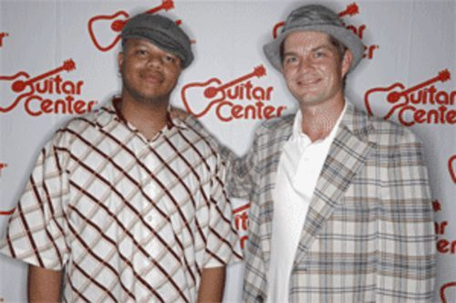 Lancaster's Jamil Byrom (left) poses with No Doubt drummer Adrian Young after winning the 2005 Guitar Center Drum Off.