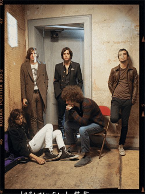 """You don't grow up thinking, 'I'm going to do interviews and photo shoots,'"" Strokes guitarist Albert Hammond Jr. (second from right, sitting) tells us sometime after this photo was taken."