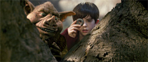 Mike Huckabee gets a cameo with Freddie Highmore in Spiderwick.