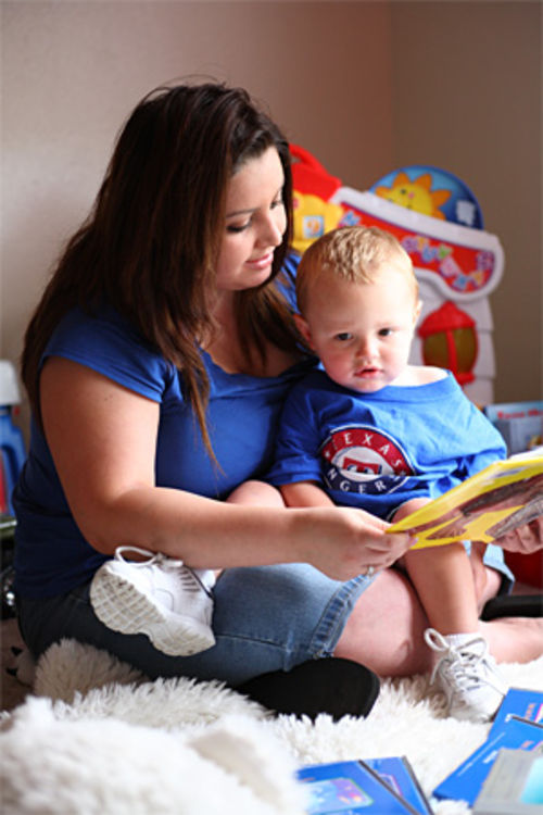 Stacey Markham reads to Daniel at their Burleson home.