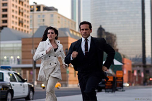 It's hard to run that fast when you have a phone in your shoe: Anne Hathaway and Steve Carell reprise Get Smart.