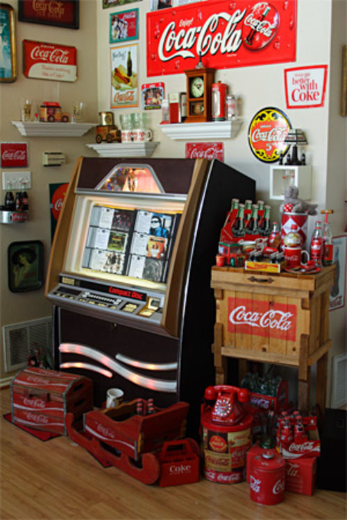 The 100-CD jukebox is flanked by Williams' other toys, including a working slot machine and an old-school Coke machine.