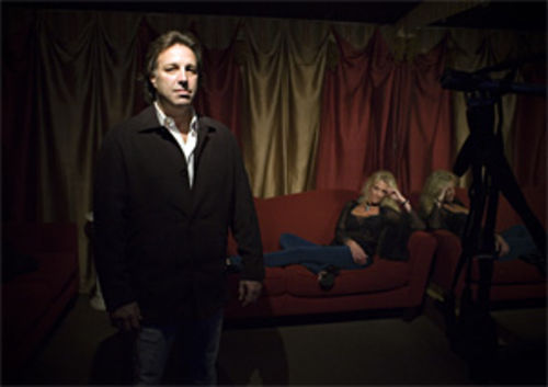 "Rick Reid is a co-owner of IniQuity, a wildly successful ""couples club"" in Dallas that welcomes displays of ""playful behavior"" among its members while at the club. Seated is his wife, Tami, who is also an IniQuity co-owner."
