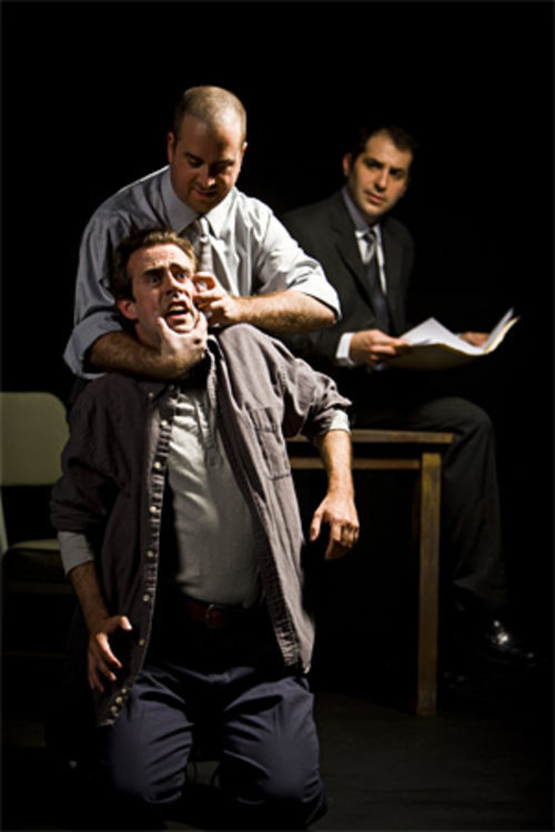 Lee Trull (foreground), Michael Federico and Ian Leson wrestle with the complexities of The Pillowman at Kitchen Dog Theater.