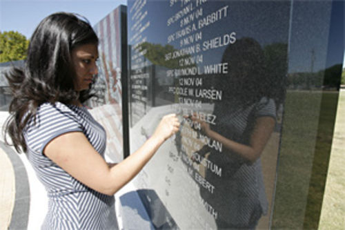 Monica Velez cleans Freddy's name, engraved in a memorial at Fort Hood, Texas.