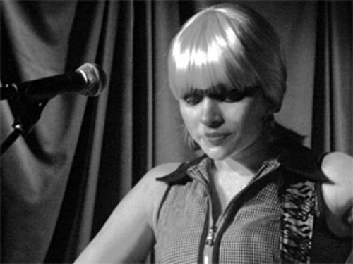 Who knew the other side of Norah Jones involved a blond wig?