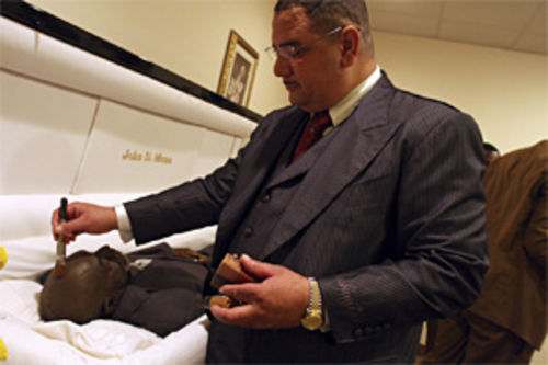 Beckwith Jr. applies final touches to a body, striving to make everything perfect, his funeral home's goal.