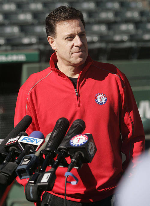 Chuck Greenberg's pullover may be red, but his financial plan is to keep the Rangers in the black.