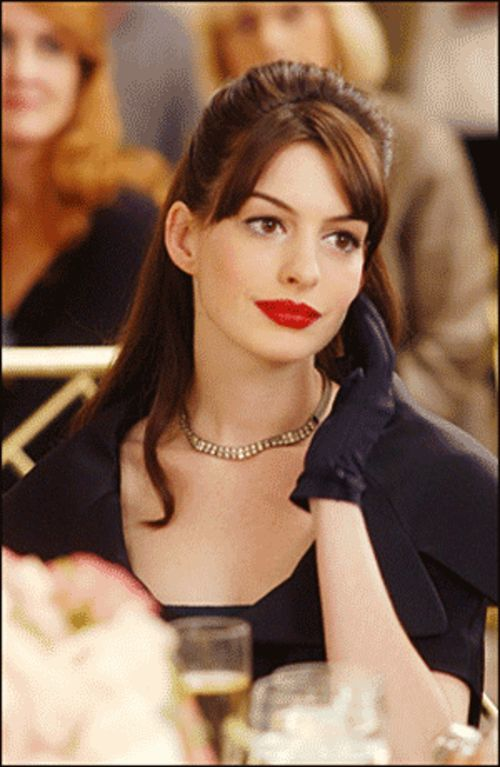 The Devil Wears Prada's Anne Hathaway wants to be a journalist for all the nifty clothes. Yeah, reporters are fashion plates. Sure they are.