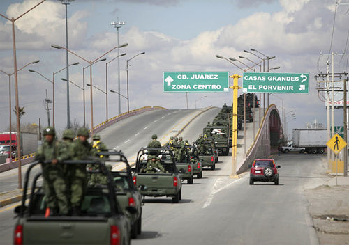 A Mexican military convoy moving through Juárez is indicative of the state of siege the once popular tourist destination is under.