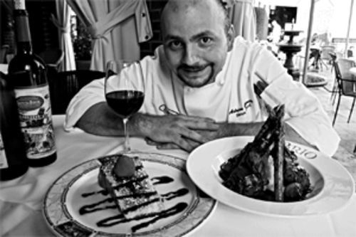 Chef Adrian Garcia, with grilled lamb chop and asparagus and Tuscan mashed potatoes, along with cheesecake for dessert. Question: Why doesn't this man weigh 400 pounds?
