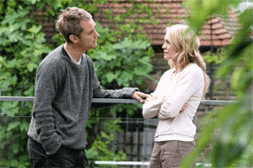 Jude Law is a gloomy Brit married to a depressed Swede, Robin Wright Penn. Good times.