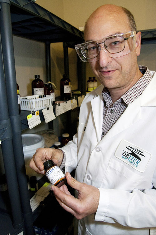 Bill Bollinger, CEO of Obiter Research, holds a few grams of 18-MC (18-methoxycoronaridine), a synthetic ibogaine derivative that he believes can cure drug addiction.