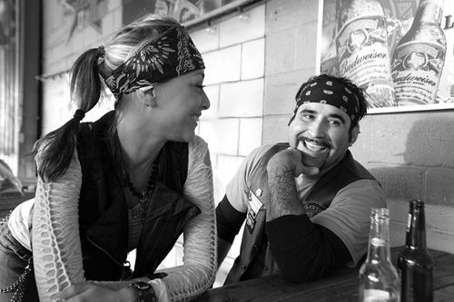 Healed by weekend rides, Rico's sister, Lisa Santos, and Bastard brother, Gonzo, share a laugh at Strokers.