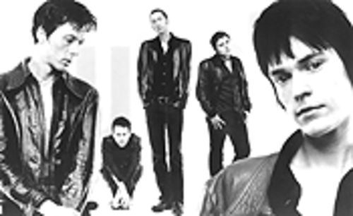 Back in black: The London Suede is, from left, Brett Anderson, Simon Gilbert, Mat Osman, Richard Oakes, and Neil Codling.
