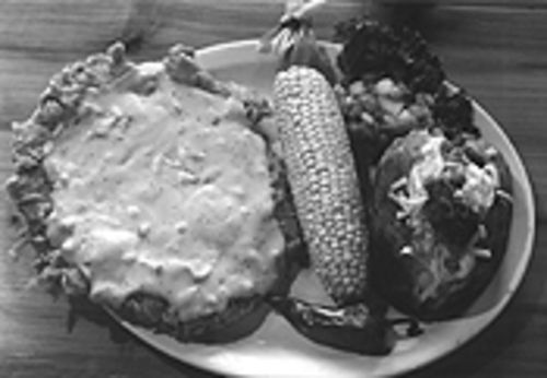 The chicken-fried steak at Love & War in Texas spills over the plate, while the Texana spills over the restaurant.
