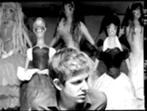 """Am I going to get lucky?"" Spoon singer-guitarist Britt Daniel asks himself. Of course, he's talking about songwriting, rather than the dolls sitting behind him (we hope)."