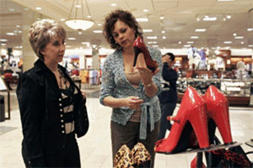 At the Galleria Nordstrom, Lin Tanner (left) gets a lesson in this season's patent leather shoe trend from personal shopper Vanessa Williams.