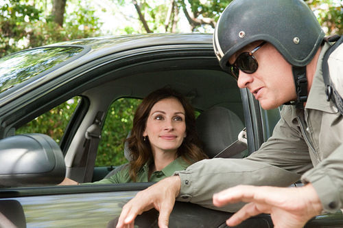 Tom Hanks goes through the easiest mid-life crisis in history in Larry Crowne. Hanging out with Julia Roberts helps.