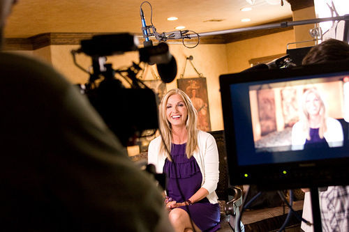 The camera rolls as Donna Moss explains her bold decorating choices for her long-time client's Keller home.