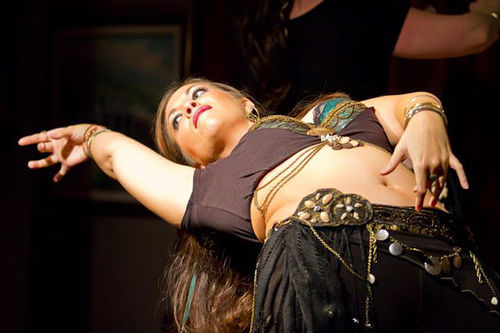 Bards and belly dancers share the spotlight at the weekly Open Stage showcase in Richardson.