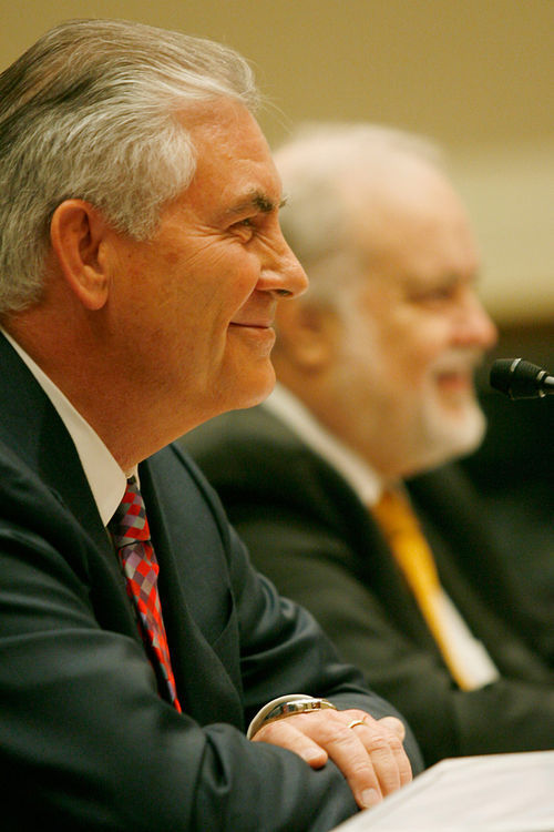 "ExxonMobil CEO Rex Tillerson (left) and XTO founder Bob Simpson testify before Congress about the controversial drilling process called ""fracking."""