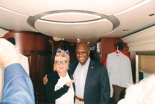 Jackson with pizza magnate and former Republican presidential candidate Herman Cain.