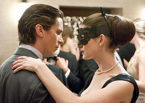 Christian Bale and Anne Hathaway, gloomy as a dark night.