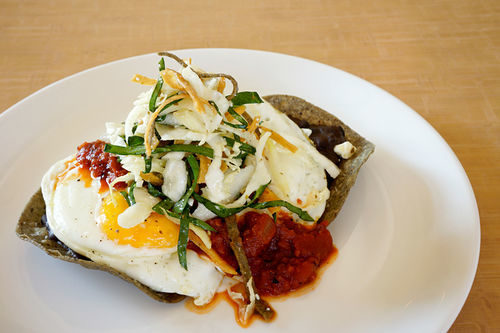 Black bean and fried egg chalupas with ranchera salsa, cotija and tortilla slaw.