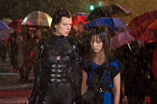 Jovovich (left) does her leather catsuit thing.