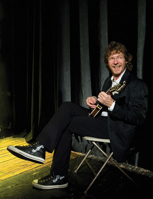 Sam Bush, sittin' and pickin'.