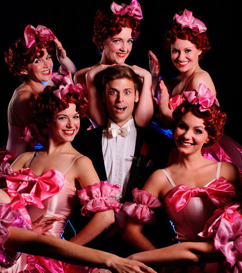 Sam Beasley plays aspiring hoofer Bobby Child, surrounded by showgirls in Theatre Three's Crazy for You.