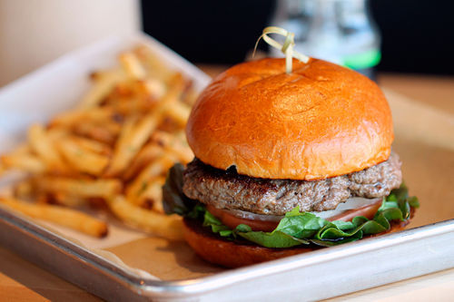 Hopdoddy's house-ground burger on a scratch-baked bun.