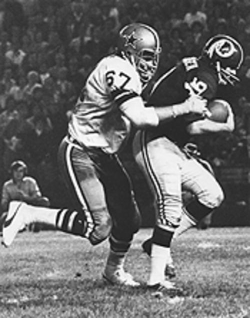 Toomay played defensive end for the Cowboys from 1970 to '74. Here, he's bringing down the Washington Redskins' future Hall of Fame quarterback Sonny Jurgenson.
