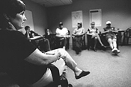 The New Place's Carolyn Tartaro conducts the last group session inside the New Place. The first drug treatment center of its kind in Dallas, the New Place became the first casualty in a new experiment in managed health care for Dallas County's low-income addicts and mentally ill residents when it closed its doors on October 15, 1999.