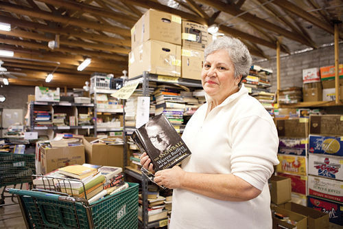 Barbara Simonick, communications director for VNSA in the organization's book-sorting warehouse in Phoenix