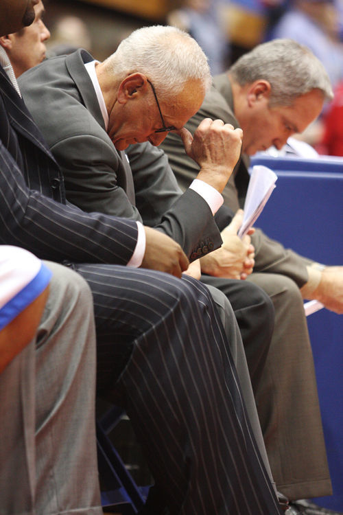 Larry Brown tries his best to stay in his chair.