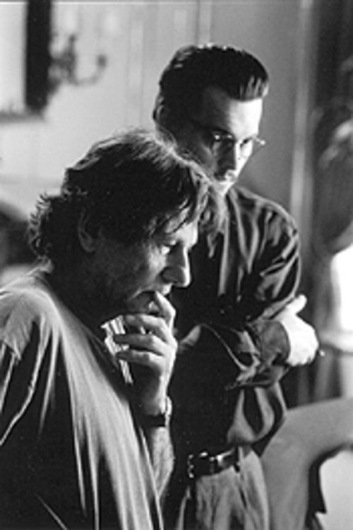 Roman Polanski and Johnny Depp stare into the beady eyes of evil on the set of The Ninth Gate.