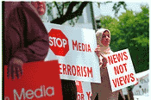Demonstrators gather outside the Morning News last week, claiming the paper is biased against Islam.