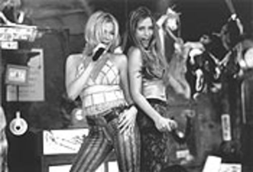 LeAnn Rimes, left, the Tiffany of country music, sings with Piper Perabo, the Carrot Top of acting, in Coyote Ugly.
