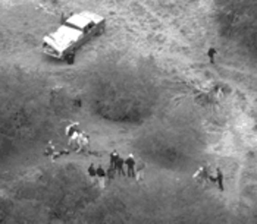 Authorities dig for the remains of Madalyn Murray O'Hair with help from convict Danny Waters, foreground, third from left.