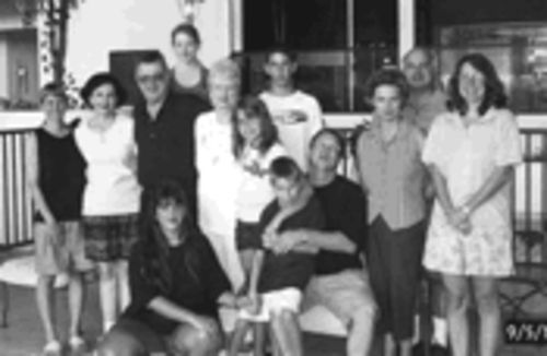 During much of their 13-year-marriage, Doug Watkins (seated right) claims that his wife, Kandee (seated left), tried to put their kids in the middle of their arguments.