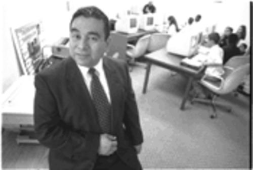 Renato De Los Santos, who directs LULAC�s educational service center in Dallas, blames lack of community progress, in part, on an abundance of low-wage work.