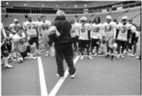 Desperados head coach Joe Avezzano addresses the team after a minicamp at Texas Stadium.