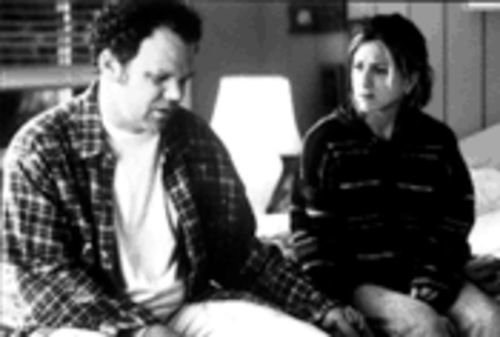 John C. Reilly and Jennifer Aniston are a couple...of small-town losers, more or less.