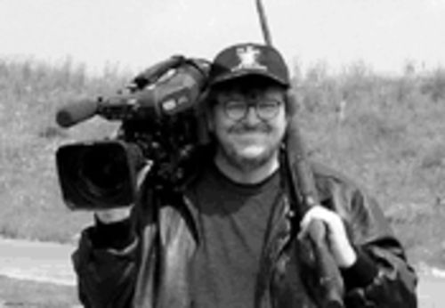 Moore of the same: The gonzo documentarian always operates with a camera--and a chip--on his shoulder.