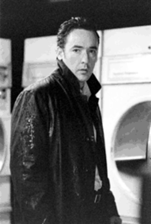 Killing, not killing time: John Cusack is, or isn't, a former cop in the horribly fun Identity.
