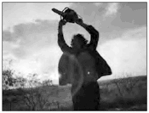 Damn those meddlin' kids: Leatherface performs the chain saw swing dance of despair.